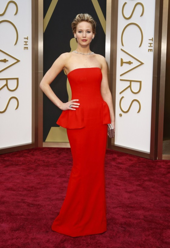 Jennifer Lawrence in Dior Haute Couture, Salvatore Ferragamo clutch and Neil Lane jewels.